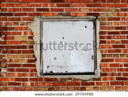 Blank metal sign on brick wall