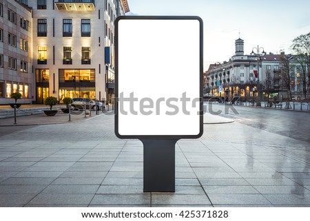 Blank mock up of vertical street poster billboard on city background - stock photo