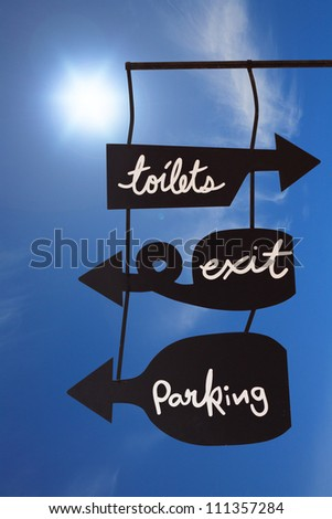 Blank modern hanging sign with space text with blue sky - stock photo