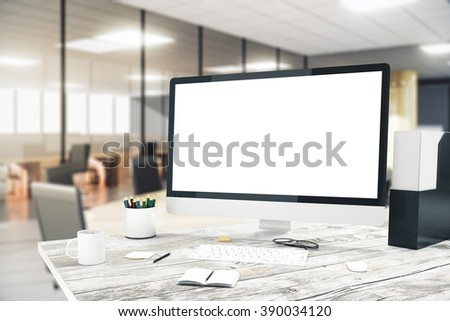 Blank monitor on wooden desktop with blurry office in the background, mock up, 3D Render - stock photo