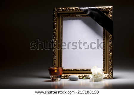 blank mourning frame with flower and candle light  - stock photo