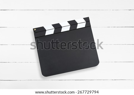Blank movie clapper board against white wooden texture - stock photo
