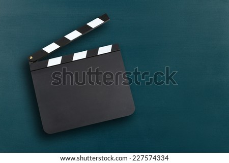 Blank movie clapper board with copy space - stock photo
