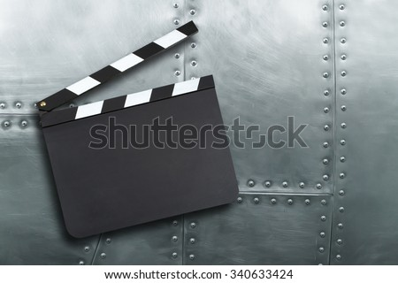 Blank movie production clapper board on vintage metal background - stock photo