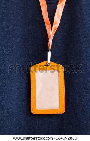 Blank name leather badge on blue background2 - stock photo