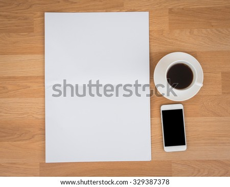 Blank Newspaper with empty space and coffee cup ,mobile phone mock up on wood background - stock photo