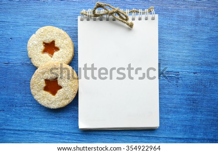 Blank note and christmas cakes.Blank note for recipes.Christmas and New Year background - stock photo