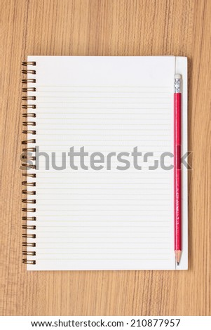 Blank Note Book on Grunge Wood.