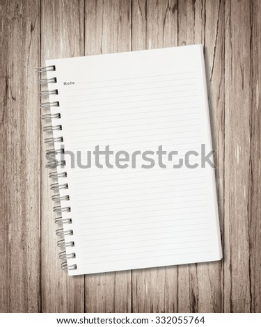 Blank note book on wood background