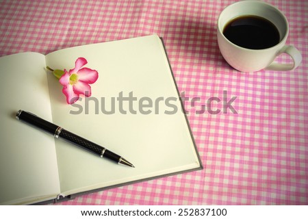 Blank note book with cup of coffee and flower, Vintage style - stock photo