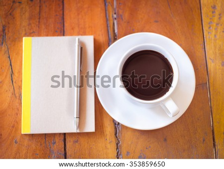 Blank note book with cup of coffee, Vintage style