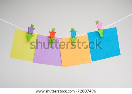 blank note hanging on the clothesline isolated on white background