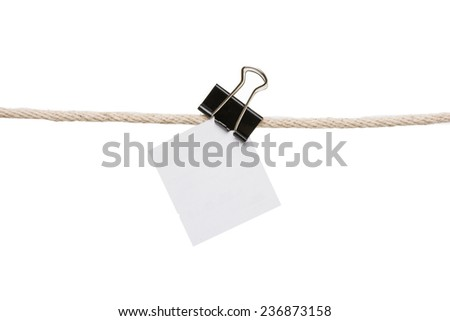 blank note on rope over white background - stock photo