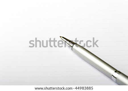 Blank note pad sheet with a pen for writing