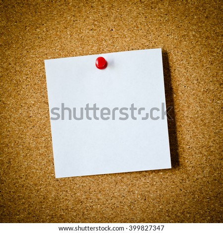 blank note paper on a cork board