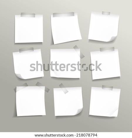 blank note paper set on grey background