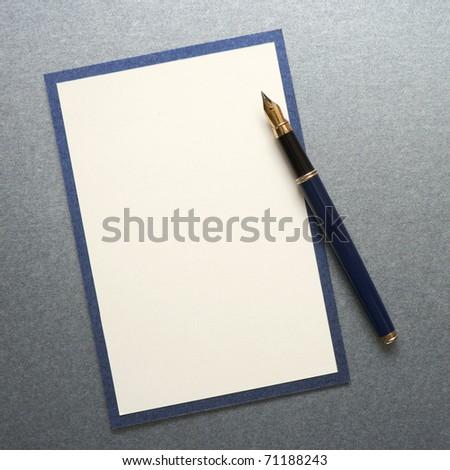 Blank note paper wiih pen - stock photo
