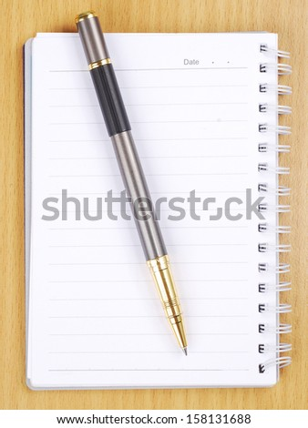 Blank note paper with gold pen