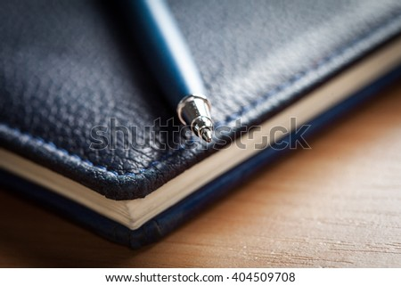 Blank note paper with pen on wood background - stock photo