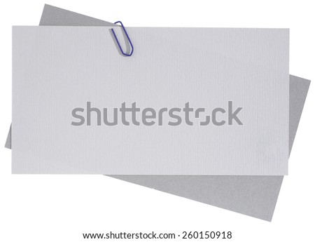 Blank note papers connected with staple - stock photo