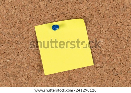 Blank note pinned to corkboard  - stock photo