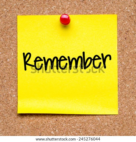 Blank note with remember. Blank yellow sticky note with remember word pined on a cork bulletin board. - stock photo