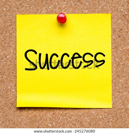 Blank note with success. Blank yellow sticky note with success word pined on a cork bulletin board. - stock photo