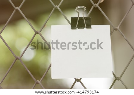 Blank Note with the phrase don't miss the deadline on steel wire mesh fence background - stock photo