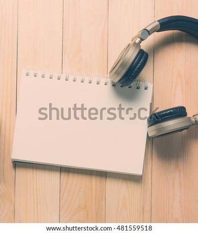 Blank notebook empty page with golden headphone