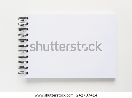 Blank notebook for painting, drawing and sketching on white background. - stock photo