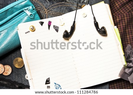 Blank notebook for personal entries, ear-phones and purse