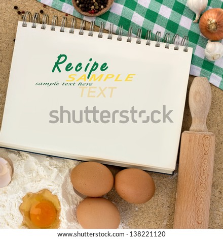 blank notebook for recipes with baking ingredients - stock photo