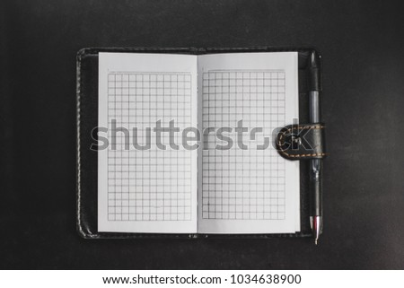 blank notebook on a black background