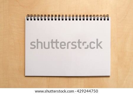 Blank notebook on a desk, top view