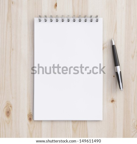 blank notebook on a wooden table - stock photo