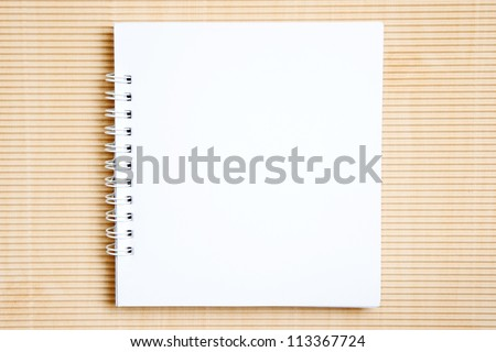 Blank notebook on brown paper background - stock photo