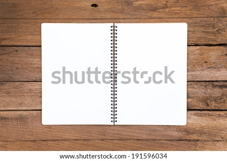 Blank notebook on old wooden background - stock photo