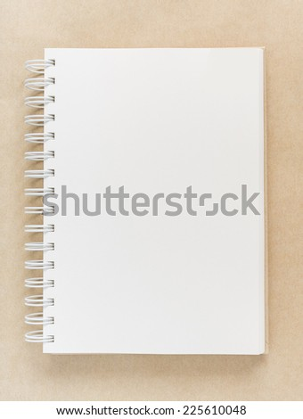 Blank notebook on vintage paper background. - stock photo