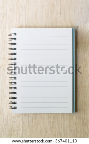 blank notebook on wooden table, business concept - stock photo