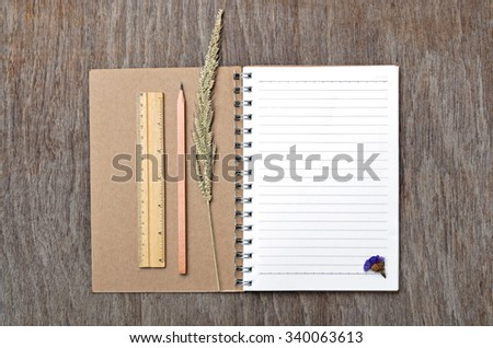 Blank Notebook on Wooden Table for Texture Background