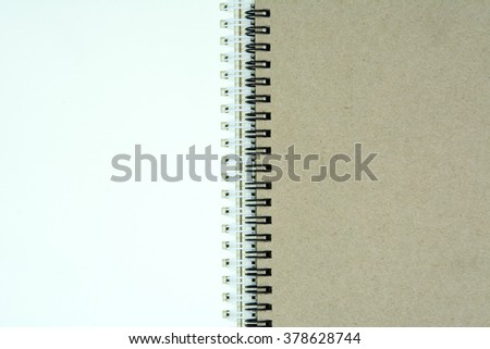 blank notebook on wooden table. top view
