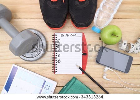 Blank notebook page. Writing to do list on wooden background for recording concept of weight loss, diet - stock photo