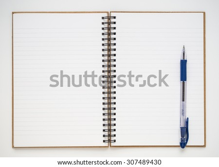 Blank notebook with blue pen on white background - stock photo