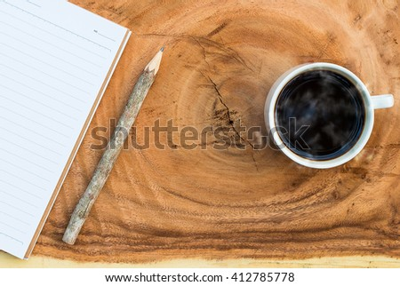 Blank notebook with Coffee cup with hot coffee copy space
