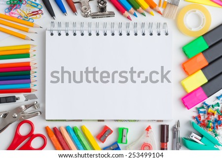 Blank notebook with colourful crayons - stock photo