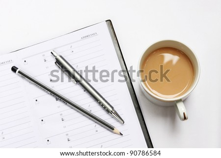 Blank notebook with pen and coffee cup - stock photo