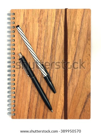 blank notebook with 2 pen and penl on wooden table, business concept - stock photo