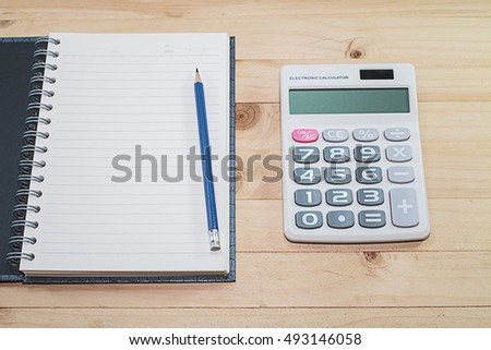 Blank notebook with pencil  on table background  / selective focus