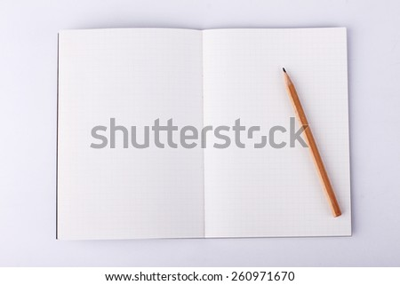 blank notebook with pencil on white background, business concept - stock photo