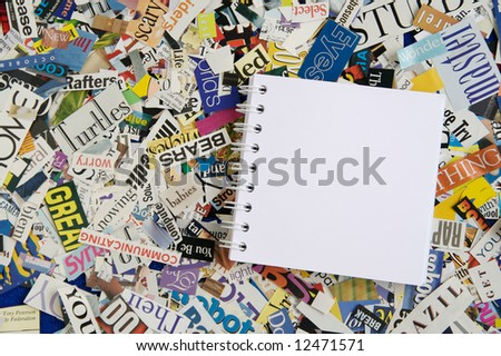 Blank Notepad on Magazine Clipping Background - stock photo